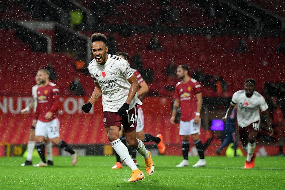 Pierre-Emerick Aubameyang celebrates after scoring from the penalty spot during the Premier League match between Manchester United and Arsenal.
