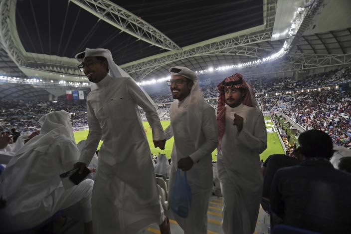 FILE - In this May 16, 2019, file photo, spectators leave their seats during the final soccer match half-time during the inauguration ceremony of the Al Janoub Stadium, formerly known as Al Wakrah Stadium, in Doha, Qatar. Qataris awoke to a surprise blockade and boycott by Gulf Arab neighbors 3 1/2 years ago, and this week were jolted again by the sudden announcement that it was all over. (AP Photo/Kamran Jebreili, File)