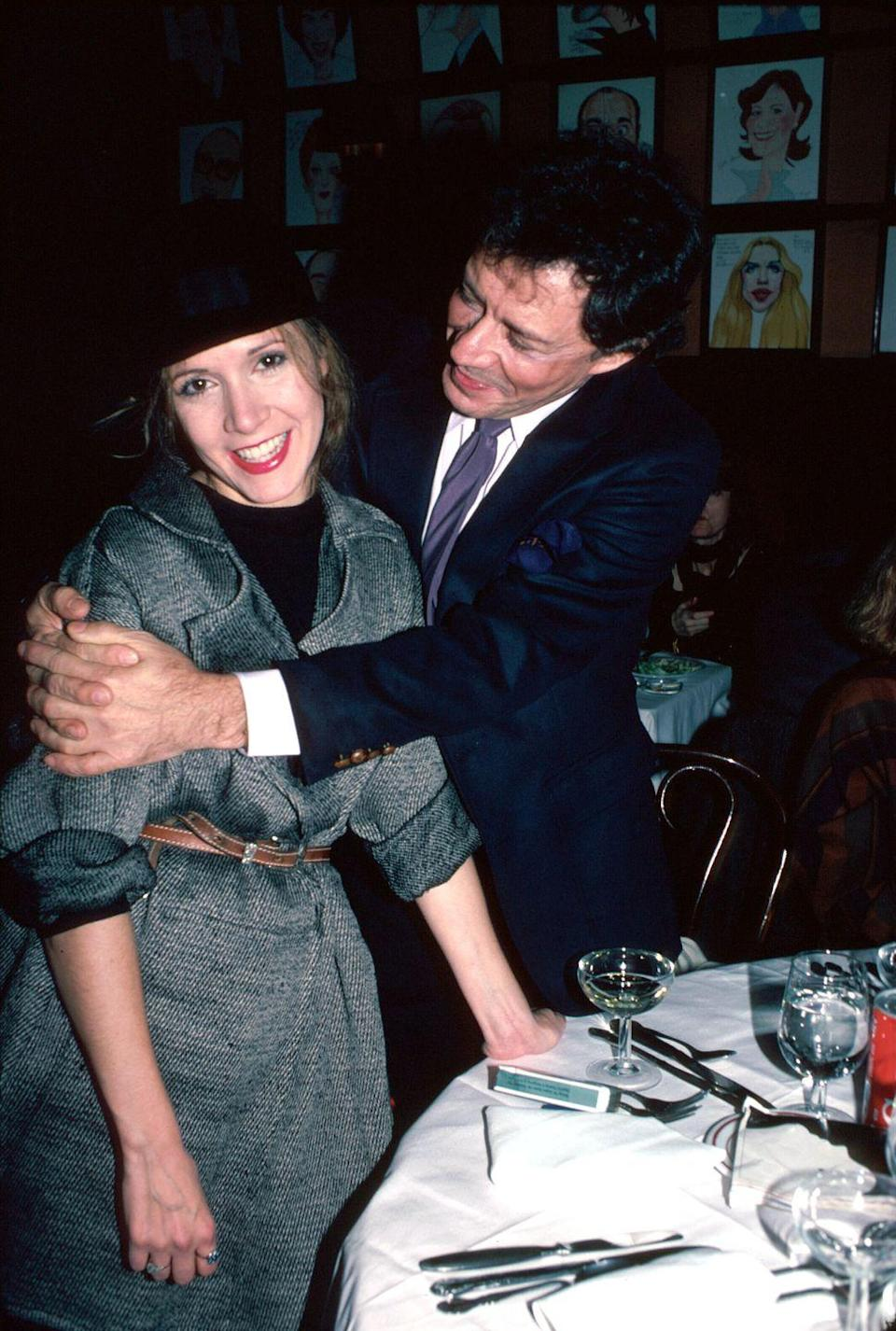 "<p>The actress returned to the stage on Broadway once again for the play <em>Agnes of God </em>in 1983. Here, she's seen with her father Eddie, whom she's been honest about having a strained relationship with. ""He defined me more by his absence than by presence,"" Fisher <a href=""https://www.nytimes.com/2010/12/05/arts/television/05fisher.html"" rel=""nofollow noopener"" target=""_blank"" data-ylk=""slk:told The New York Times"" class=""link rapid-noclick-resp"">told <em>The New York Times</em></a><em>. </em></p>"