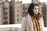 <p>In the first episode, Mabel swaps her marigold Michael Kors jacket for a cream teddy coat and camel coloured check scarf.</p>