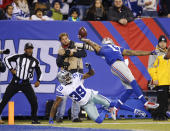 FILE - In this Nov. 23, 2014, file photo, New York Giants wide receiver Odell Beckham Jr. (13) makes a one-handed catch for a touchdown against Dallas Cowboys cornerback Brandon Carr (39) in the second quarter of an NFL football game in East Rutherford, N.J. The one-handed catch by Odell Beckham Jr. that became the most talked-about play from Sunday did more than just boost his standing with the New York Giants, it paid off a routine growing popular among many skill players of practicing the impractical, one-handed circus grab. (AP Photo/Kathy Willens, File)