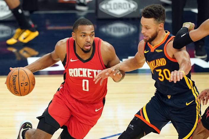 The Houston Rockets' Sterling Brown, left, working against Golden State Warriors guard Stephen Curry (30) during and April 10 game, was assaulted Sunday night in Miami.