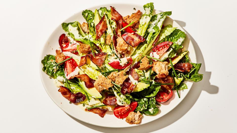 "Cooking bacon in the oven on a sheet tray is so hands-off, so splatter-free, and so easy, it just might convince you to eat a lot more bacon in the future. <a href=""https://www.bonappetit.com/recipe/blt-salad?mbid=synd_yahoo_rss"" rel=""nofollow noopener"" target=""_blank"" data-ylk=""slk:See recipe."" class=""link rapid-noclick-resp"">See recipe.</a>"