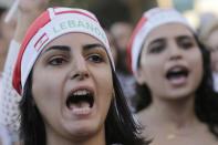 Anti-government protesters shout slogans against the Lebanese government during a protest in Beirut, Lebanon, Monday, Oct. 21, 2019. Lebanon's Cabinet approved Monday sweeping reforms that it hopes will appease thousands of people who have been protesting for five days, calling on Prime Minister Saad Hariri's government to resign. (AP Photo/Hassan Ammar)