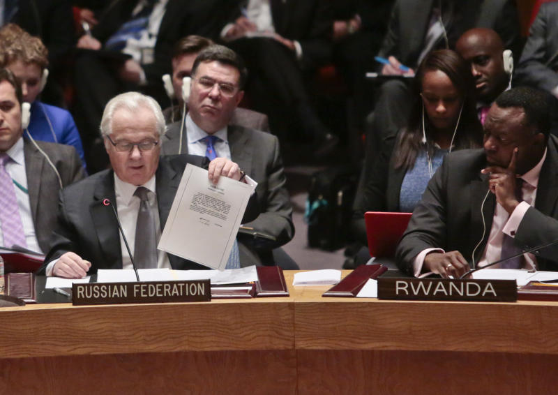 U.N. Russian Ambassador Vitaly Churkin shows a document as he speaks during a meeting of the U.N. Security Council, Monday, March 3, 2014 at U.N. headquarters. (AP Photo/Bebeto Matthews)