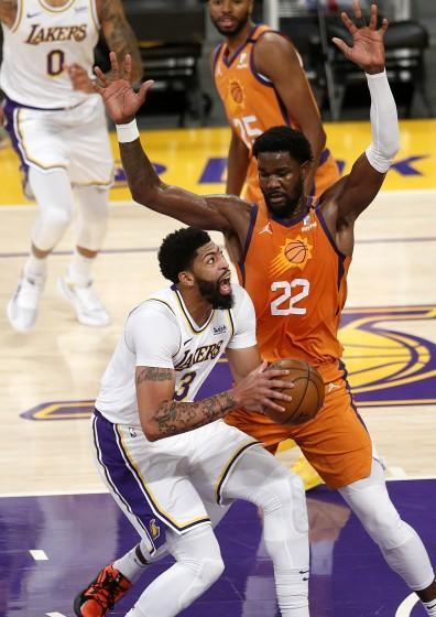 LOS ANGELES, CA - MAY 30: Los Angeles Lakers forward Anthony Davis (3) is guarded by Phoenix Suns center Deandre Ayton.