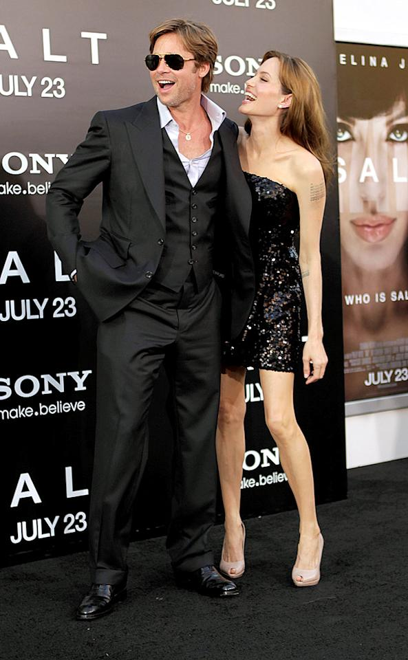 "Brad Pitt and Angelina Jolie, playing up the Brangelina magic at the ""Salt"" premiere, accepted undisclosed damages in a privacy claim against <i>News of the World</i> Thursday after the British tabloid had reported last January they were planning to split. An UsMagazine.com source reported that ""the money will be donated to the Jolie-Pitt foundation. After tax and fees, every penny will be donated."" Jeff Vespa/<a href=""http://www.wireimage.com"" target=""new"">WireImage.com</a> - July 19, 2010"