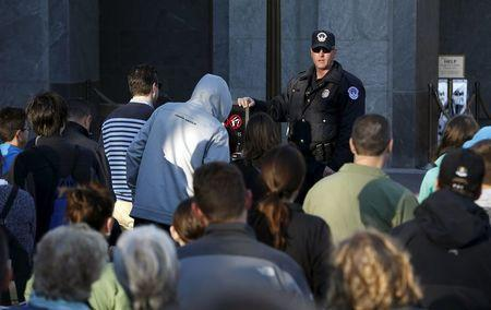A United States Capitol Police officer watches people enter the U.S. Capitol Visitors Center in Washington March 29, 2016. REUTERS/Gary Cameron