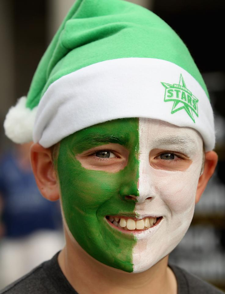 MELBOURNE, AUSTRALIA - DECEMBER 20:  A fan has his face painted showing his support during the Big Bash League match between the Melbourne Stars and the Melbourne Renegades at Melbourne Cricket Ground on December 20, 2013 in Melbourne, Australia.  (Photo by Robert Prezioso/Getty Images)