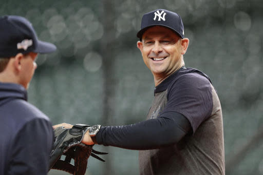 New York Yankees manager Aaron Boone, right, takes part in a team workout for a baseball American League Championship Series in Houston, Friday, Oct. 11, 2019. New York will face the Houston Astros, Saturday. (AP Photo/Eric Gay)