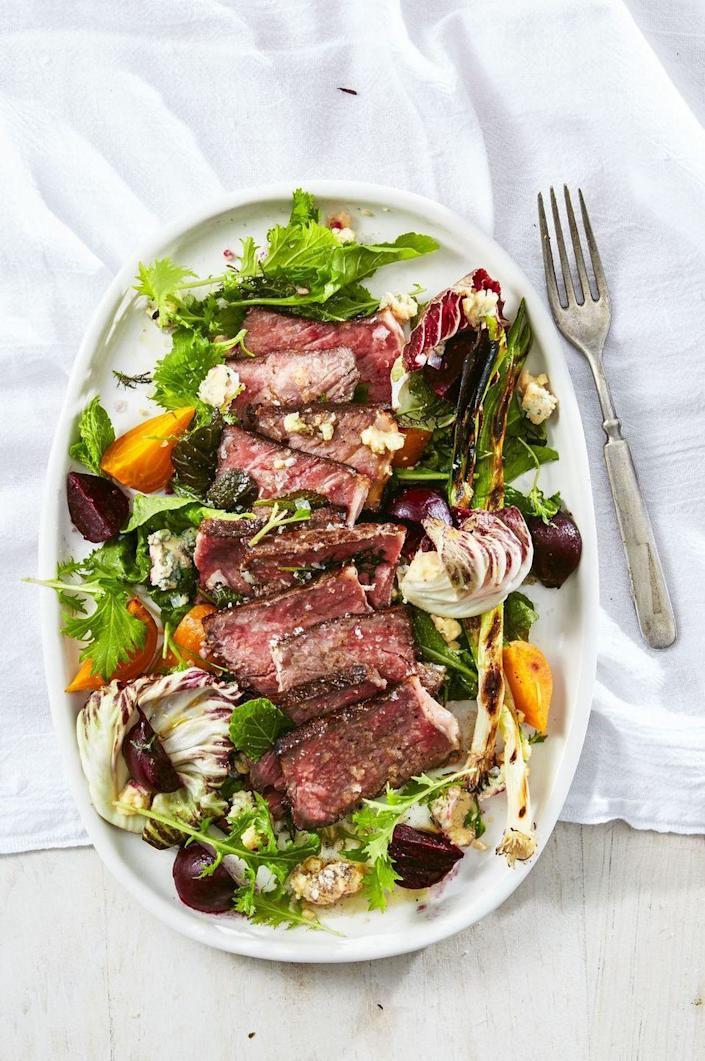 """<p>Steak can be part of a healthy dinner, and this 315-calorie plate is proof! Harness the power of sous vide to ditch fatty oils when cooking up lean beef.</p><p><a href=""""https://www.goodhousekeeping.com/food-recipes/easy/a36253/steak-salad-with-charred-green-onions-and-beets/"""" rel=""""nofollow noopener"""" target=""""_blank"""" data-ylk=""""slk:Get the recipe for Steak Salad With Charred Green Onions and Beets »"""" class=""""link rapid-noclick-resp""""><em>Get the recipe for Steak Salad With Charred Green Onions and Beets »</em></a><br></p>"""