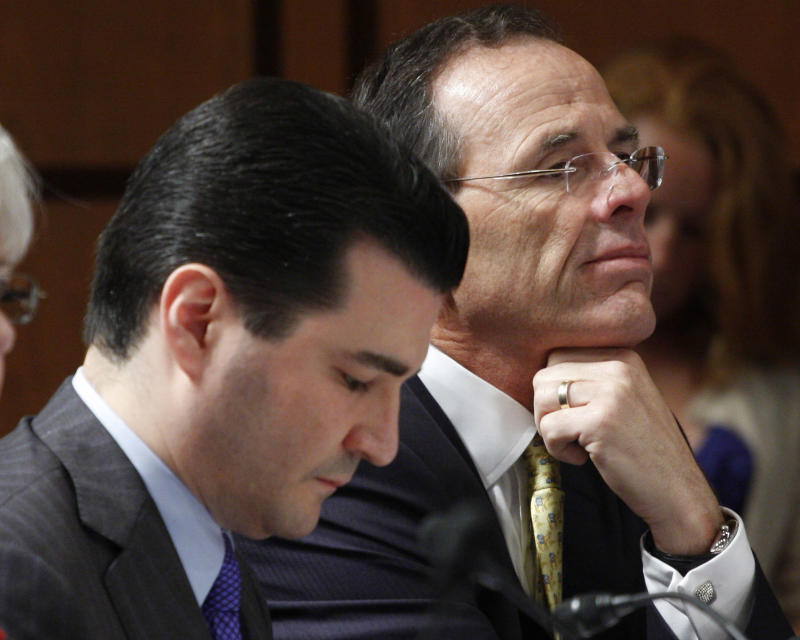 FILE - In this June 11, 2009 file photo, Dr. Scott Gottlieb, left, is seen on Capitol Hill in Washington. A White House official says President Donald Trump is choosing Gottlieb, a conservative doctor-turned-pundit with deep ties to Wall Street and the pharmaceutical industry to lead the powerful Food and Drug Administration (FDA).  (AP Photo/Harry Hamburg, File)