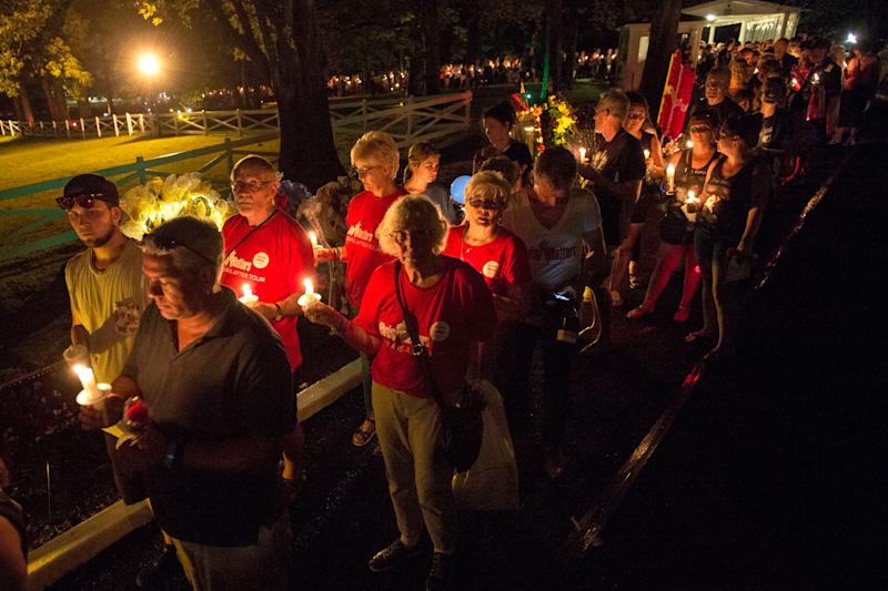 Visitors at Tuesday's candlelight vigil for Elvis Presley at Graceland