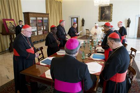 Pope Francis attends a meeting with cardinals at the Vatican October 1, 2013. REUTERS/Osservatore Romano