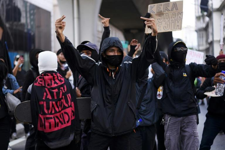 The protesters wore masks and largely kept a distance from one another