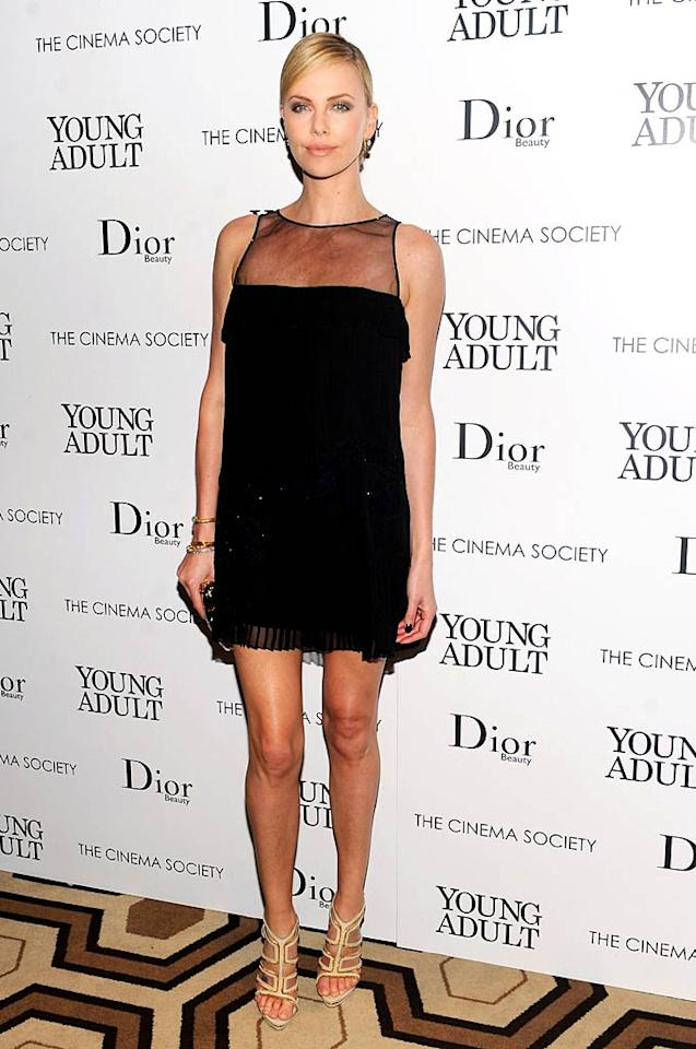 "Nobody looks better in an LBD than Charlize Theron, who wore this simple yet stunning Christian Dior design -- and nude-colored heels -- to the Cinema Society's screening of her new comedy-drama, ""Young Adult."" (11/18/2011)"