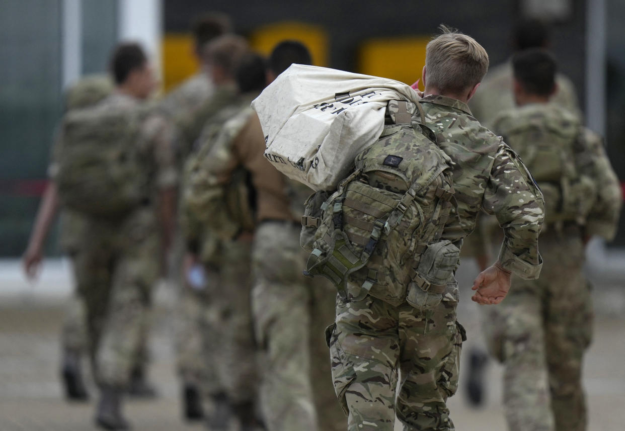 Members of the British armed forces 16 Air Assault Brigade walk to the air terminal after disembarking a Royal Airforce Voyager aircraft at Brize Norton, Oxfordshire on August 28, 2021, as the troops return from assisting with the evacuation of people from Kabul airport in Afghanistan.