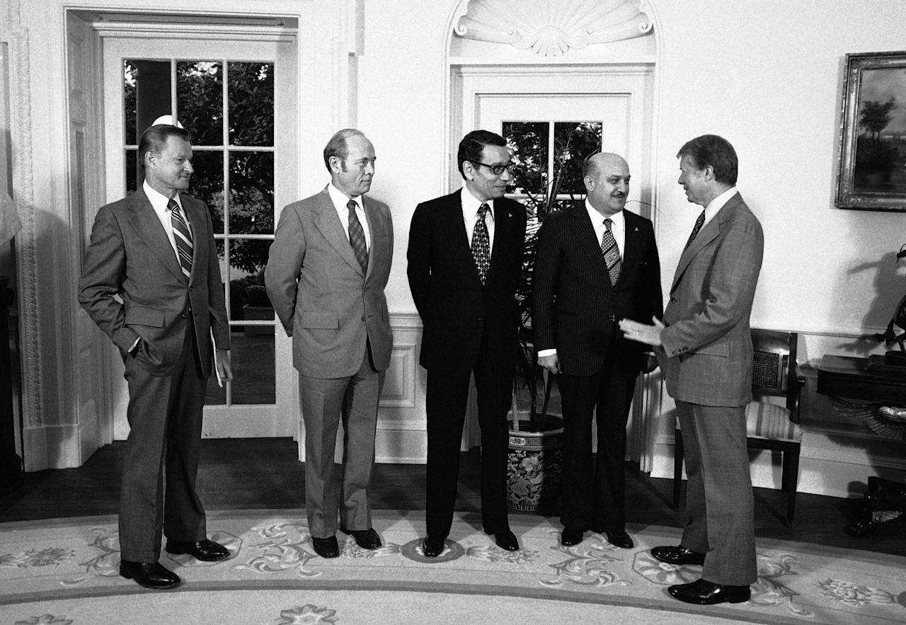 <p>President Jimmy Carter greets members of the Egyptian delegation to the Mideast peace talks at the White House, Washington on Oct. 11, 1978. From left: U.S. National Security Affairs Advisor Zbigniew Brzezinski, Amb. Alfred Atherton; acting Egyptian Foreign Minister Boutros Ghali, Egyptian Defense Minister General Kamel Hassan Ali, and Carter. (Photo: Cook/AP) </p>