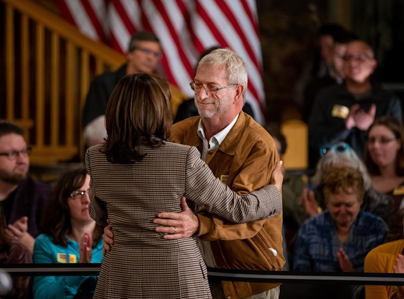 Earl Alexander gives Sen. Kamala Harris, D-Calif. a hug after she answered his question during a town hall in Dubuque Wednesday, Oct. 16, 2019.
