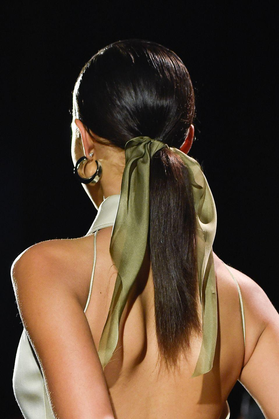 <p>Meanwhile, at Brandon Maxwell, long silk scarves added elegance to simple and sleek low ponytails. </p>