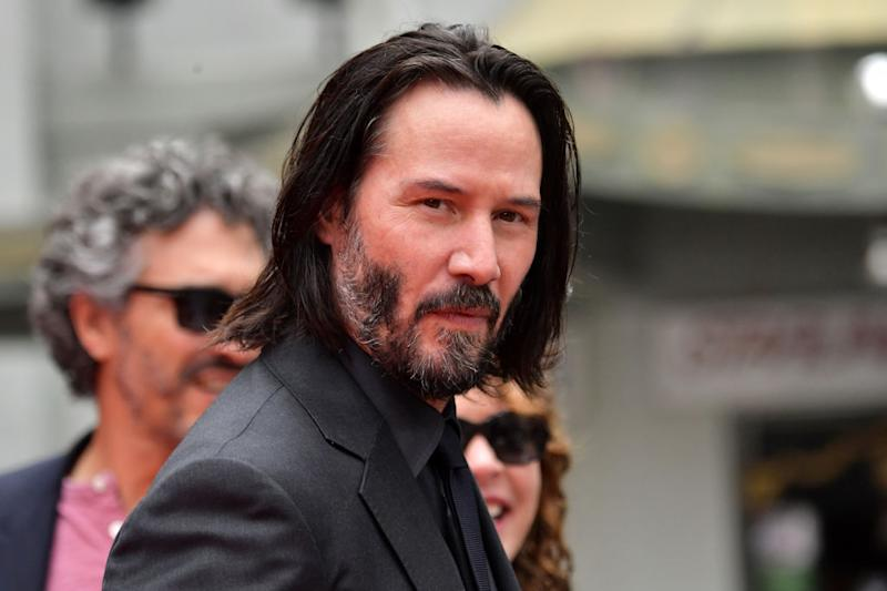 Keanu Reeves arrives for his handprint ceremony on May 14 in Hollywood, California. (Photo: Emma McIntyre/Getty Images)