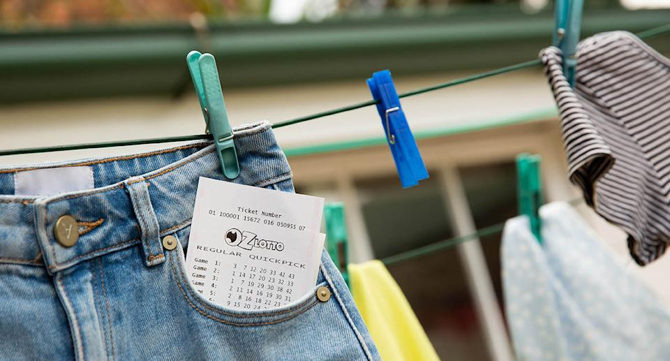 Lottery ticket sticking out of jeans on clothesline. Source: The Lott