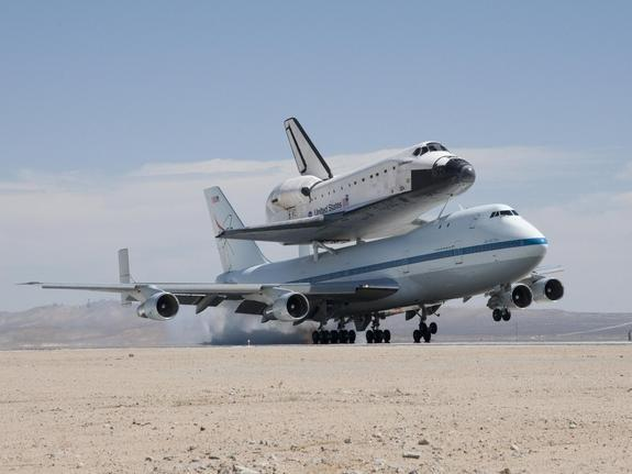 NASA's Shuttle Carrier Aircraft with the space shuttle Endeavour securely mounted on top touches down at Edwards Air Force Base after third leg of its four-segment final ferry flight from the Kennedy Space Center in Florida to Los Angeles Inter