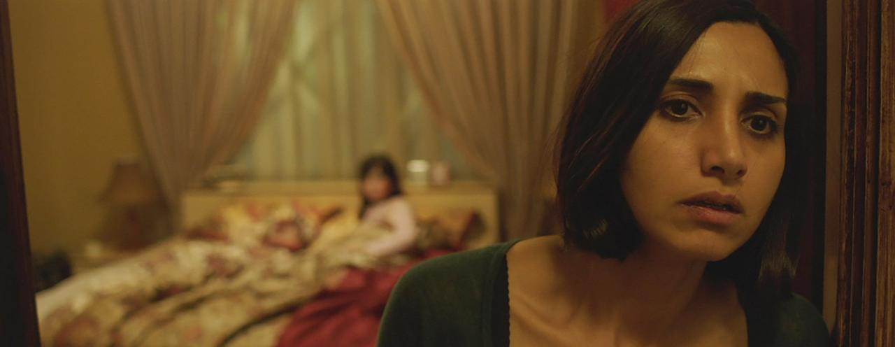"""<p><b>Under the Shadow</b> takes place in a world ever bit as scary as Camp Crystal lake or Elm Street: 1980s Tehran. The world is falling down all around a mother, who is coping not only with the war outside her windows, but a disturbing force inside her home.</p> <p><a href=""""https://www.netflix.com/title/80096786"""" target=""""_blank"""" class=""""ga-track"""" data-ga-category=""""Related"""" data-ga-label=""""https://www.netflix.com/title/80096786"""" data-ga-action=""""In-Line Links"""">Watch it now</a>.</p>"""