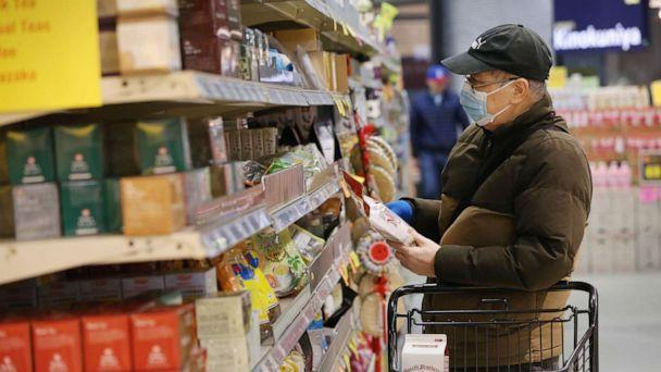 PHOTO: A man shops for groceries during special hours open to seniors only at a supermarket in Seattle, March 18, 2020. (Karen Ducey/Getty Images)