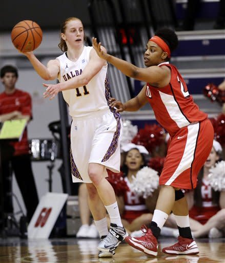 Albany forward Julie Forster (11) passes in front of Hartford forward Ruthanne Doherty (24) during the first half of their NCAA college basketball game in the championship of the America East Conference tournament, Saturday, March 16, 2013, in Albany, N.Y. (AP Photo/Mike Groll)