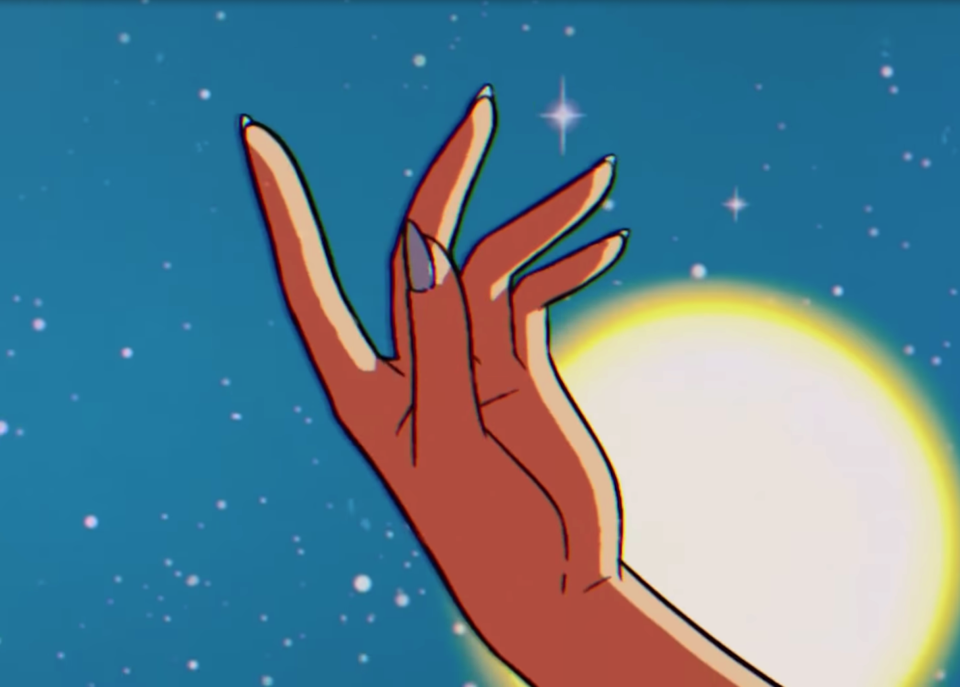 An animated hand gestures in Dua Lipa's Sailor Moon-inspired music video