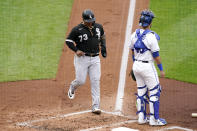 Chicago White Sox's Yermin Mercedes runs home to score past Kansas City Royals catcher Sebastian Rivero on a double by Andrew Vaughn during the first inning of a baseball game Saturday, May 8, 2021, in Kansas City, Mo. (AP Photo/Charlie Riedel)