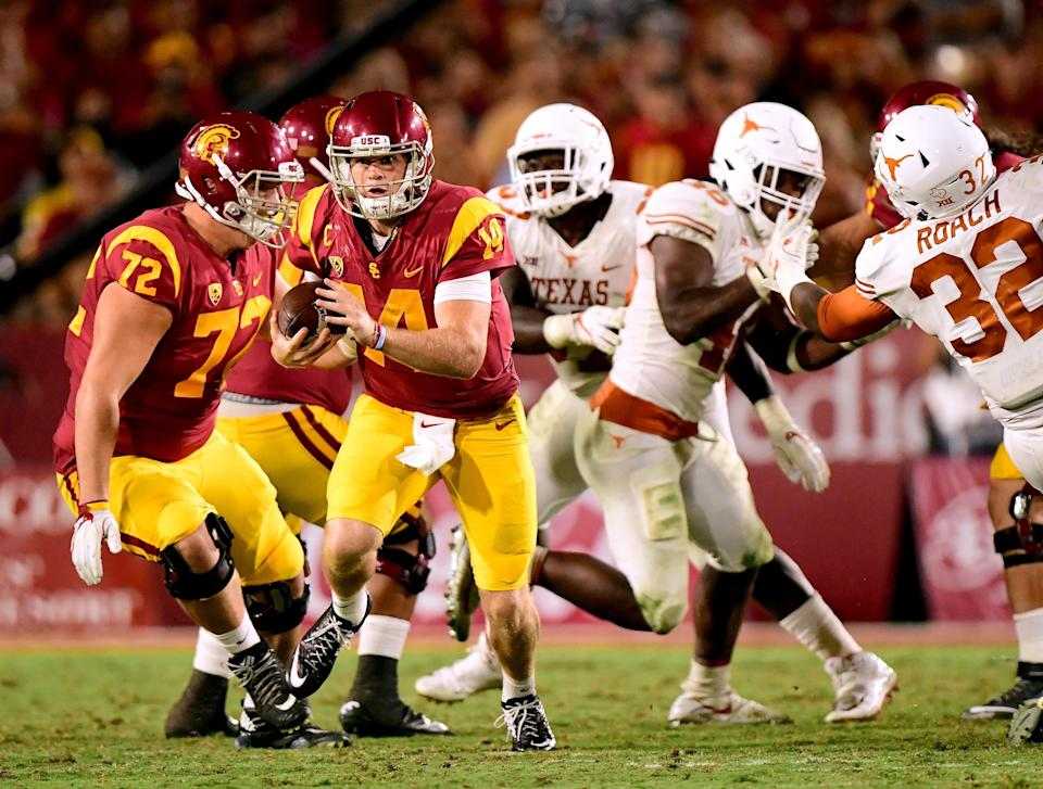 USC's Sam Darnold scrambles away from pressure during the Trojans' win over Texas on Saturday. (Getty)