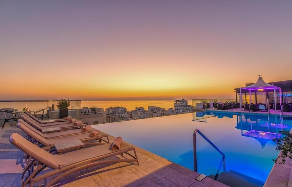 """<p>Located in stylish Sliema, a buzzing, affluent town on Malta's north-east coast, <a href=""""https://go.redirectingat.com?id=127X1599956&url=https%3A%2F%2Fwww.booking.com%2Fhotel%2Fmt%2Fthe-palace.en-gb.html%3Faid%3D1922306%26label%3Dmalta-hotels&sref=https%3A%2F%2Fwww.goodhousekeeping.com%2Fuk%2Flifestyle%2Ftravel%2Fg37028393%2Fmalta-hotels%2F"""" rel=""""nofollow noopener"""" target=""""_blank"""" data-ylk=""""slk:AX The Palace"""" class=""""link rapid-noclick-resp"""">AX The Palace</a> is kitted out with contemporary rooms, a rooftop spa and infinity pool, as well as a choice of five places to eat and drink. </p><p>Dine on east Asian-inspired dishes with views out across Sliema's harbour in the ninth-floor TemptAsian, or head up to the roof for cocktails and pizza at one of Malta's coolest night-time venues. Rooms here range from light and modern Comfort Rooms overlooking the hotel atrium, through to Designer Suites, each themed around one of the five senses.</p><p><a class=""""link rapid-noclick-resp"""" href=""""https://go.redirectingat.com?id=127X1599956&url=https%3A%2F%2Fwww.booking.com%2Fhotel%2Fmt%2Fthe-palace.en-gb.html%3Faid%3D1922306%26label%3Dmalta-hotels&sref=https%3A%2F%2Fwww.goodhousekeeping.com%2Fuk%2Flifestyle%2Ftravel%2Fg37028393%2Fmalta-hotels%2F"""" rel=""""nofollow noopener"""" target=""""_blank"""" data-ylk=""""slk:CHECK AVAILABILITY"""">CHECK AVAILABILITY</a></p>"""