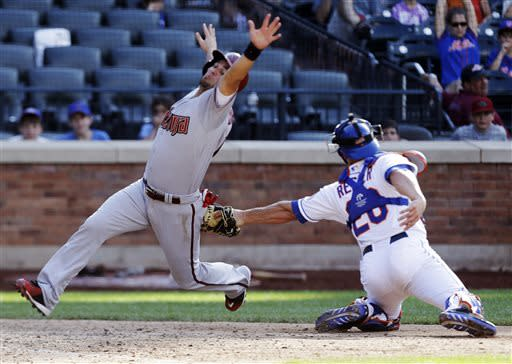 New York Mets catcher Anthony Recker (20) tags out Arizona Diamondbacks' Eric Chavez during the thirteenth inning of a baseball game Thursday, July 4, 2013, in New York. (AP Photo/Frank Franklin II)