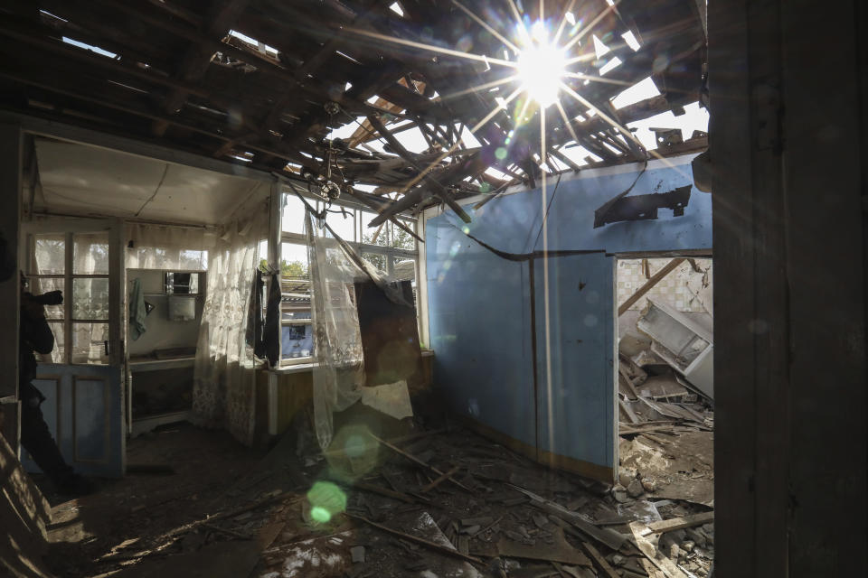 A view inside of a destroyed house in a residential area after shelling by Armenian forces in Tartar, the capital of the Tartar region of Azerbaijan, Monday, Oct. 26, 2020. Armenia and Azerbaijan are accusing each other of violating the new U.S.-brokered cease-fire aimed to halt the fighting over the separatist region of Nagorno-Karabakh. (AP Photo/Aziz Karimov)