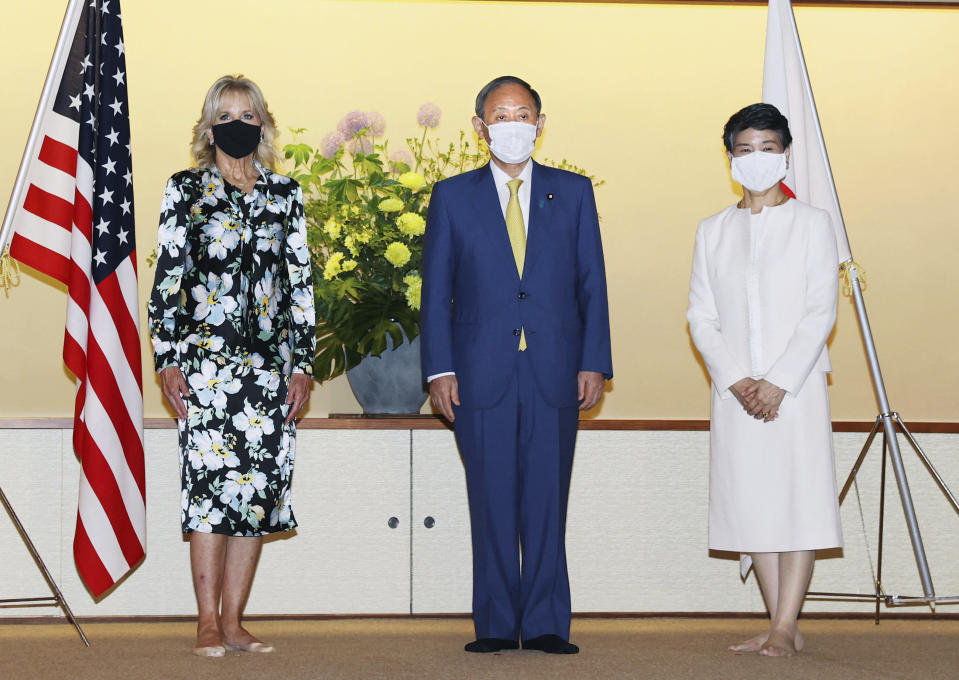 First lady of the U.S. Jill Biden poses for a photo with Japanese Prime Minister Yoshihide Suga and his wife Mariko in Tokyo, Thursday, July 22, 2021. Biden embarked on her first solo international trip as first lady, leading a U.S. delegation to the Olympic Games in Tokyo, where the coronavirus is surging and COVID-19 infections have climbed to a six-month high. (Kyodo News via AP)