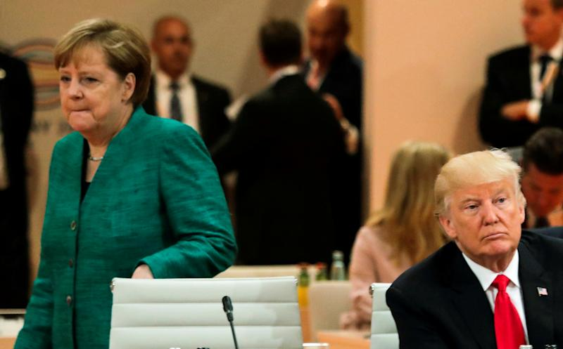 Merkel heckled twice in one day as she defends refugee policy