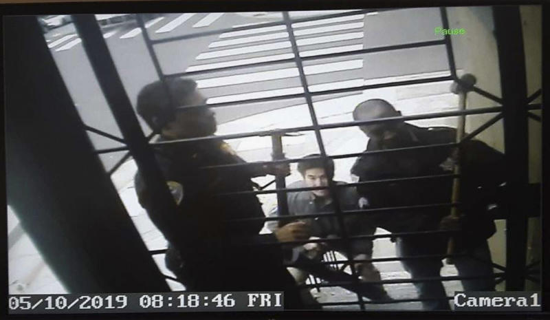 "FILE - In this May 10, 2019, image taken from video provided by Bryan Carmody, San Francisco police armed with sledgehammers execute a search warrant at journalist Carmody's home in San Francisco. San Francisco's police chief is apologizing for raiding the freelance journalist's home and office to find out who leaked a police report into the unexpected death of the city's former public defender. Chief William Scott told the San Francisco Chronicle on Friday, May 24, 2019, the searches were probably illegal and said, ""I'm sorry that this happened."" (Bryan Carmody/@bryanccarmody via AP, File)"