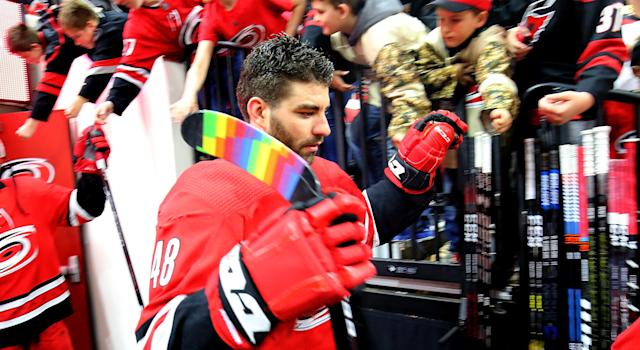 Carolina's Jordan Martinook rocks some rainbow tape on his blade to honour Pride Night on Sunday in North Carolina. (Photo by Gregg Forwerck/NHLI via Getty Images)