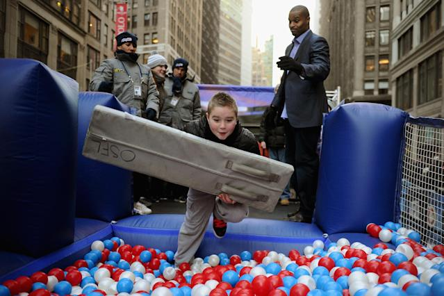 NEW YORK, NY - JANUARY 29: Zach Burrowes, 9, jumps into a ball pit presented by NFL Play 60 on Super Bowl Boulevard on January 29, 2014 in New York, New York. In preparation for the Super Bowl sections of Times Square and Broadway host various games, sponsor booths, and TV broadcasts. (Photo by Maddie Meyer/Getty Images)