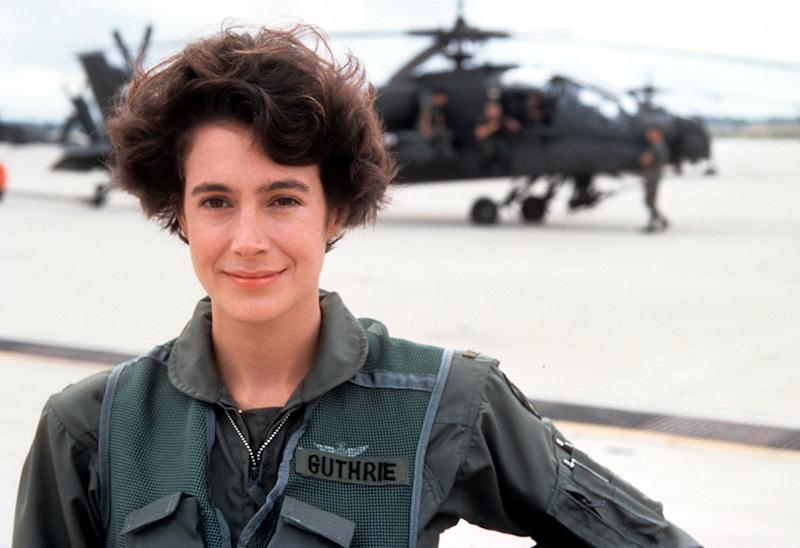 Sean Young standing on helicopter tarmac in a scene from the film 'Fire Birds', 1990. (Photo by Buena Vista/Getty Images)
