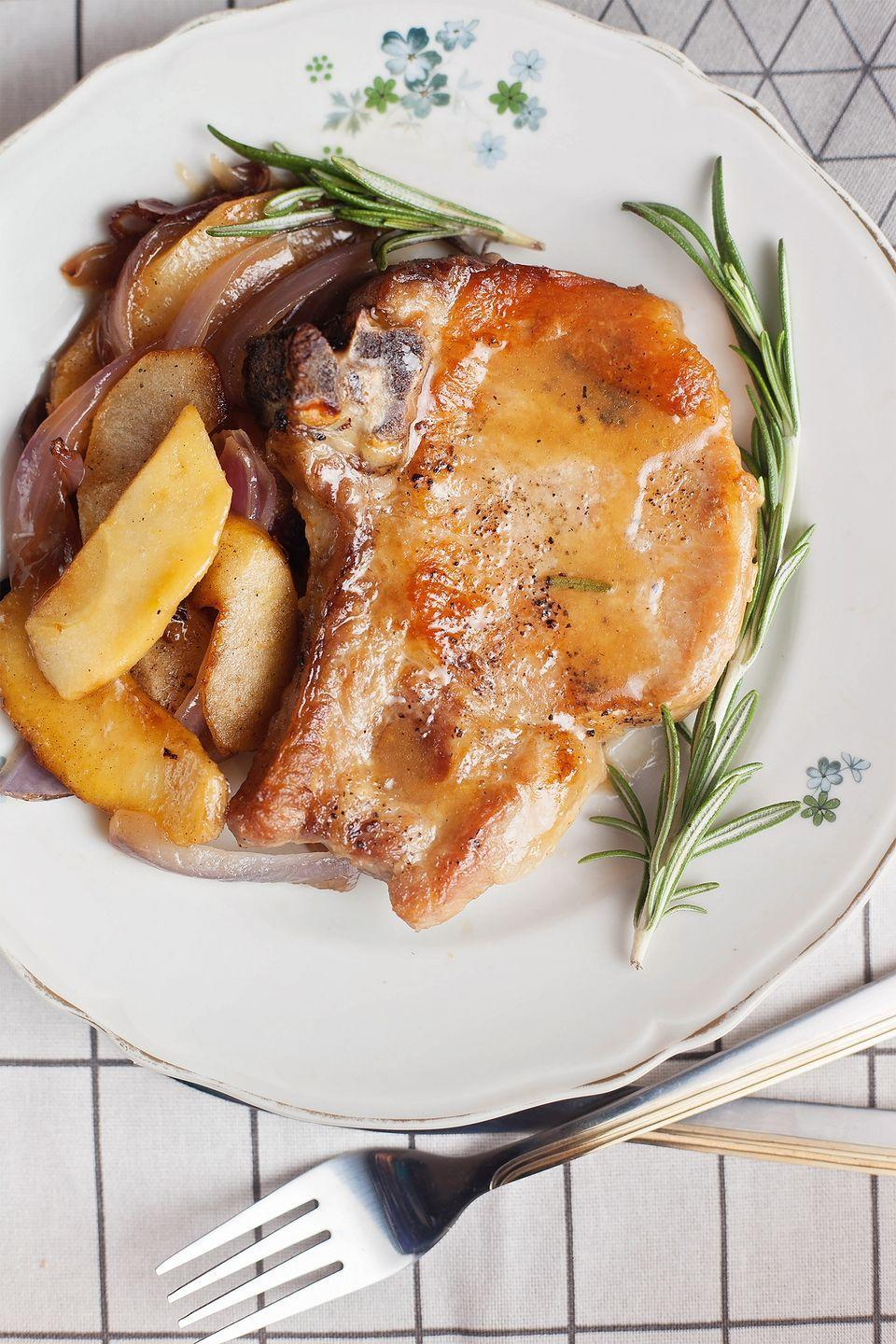 """<p>This spiced-up version of an old favorite is ready to serve in less than an hour.</p><p><strong><a href=""""https://www.countryliving.com/food-drinks/recipes/a1892/coriander-pork-sauteed-apples-onions-4074/"""" rel=""""nofollow noopener"""" target=""""_blank"""" data-ylk=""""slk:Get the recipe"""" class=""""link rapid-noclick-resp"""">Get the recipe</a>.</strong></p>"""