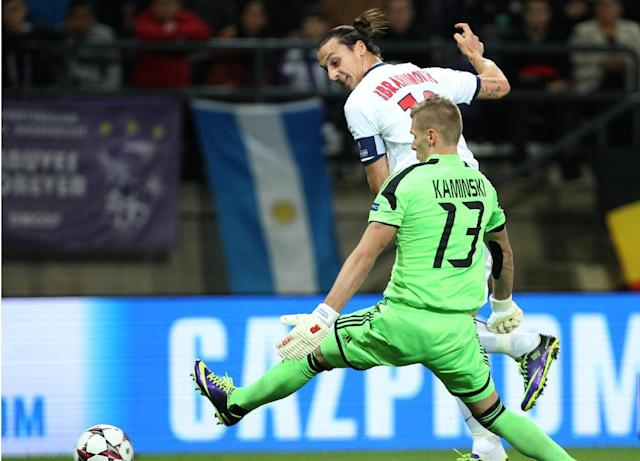 PSG's Zlatan Ibrahimovic, left, scores the opening goal while Anderlecht's goalkeeper Thomas Kaminskich looks on during their Group C Champions League soccer match, in Brussels, Belgium, Wednesday, Oct. 23, 2013. (AP Photo/Yves Logghe)
