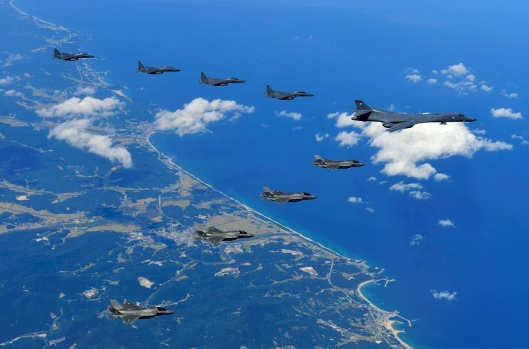 A US Air Force B-1B Lancer bomber, US F-35B stealth jet fighters and South Korean F-15K fighter jets fly over South Korea during a joint military drill