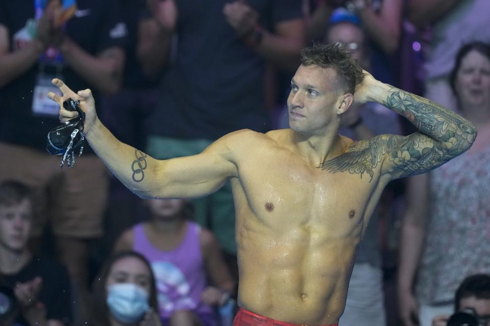 Caeleb Dressel reacts after winning the men's 50 freestyle during wave 2 of the U.S. Olympic Swim Trials on Sunday, June 20, 2021, in Omaha, Neb. (AP Photo/Charlie Neibergall)