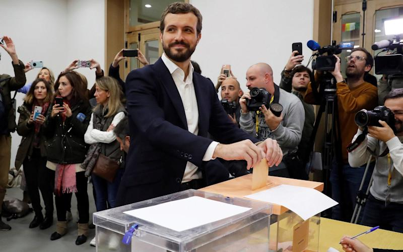 Leader of Spanish People's Party (PP) Pablo Casado (C) casts his vote at a polling station in Madrid, Spain - REX