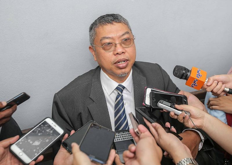 Deputy Public Prosecutor Azhar Mokthar speaks to the press after DAP assemblyman Paul Yong's proceeding at the Session Court in Ipoh November 11, 2019. — Picture by Farhan Najib