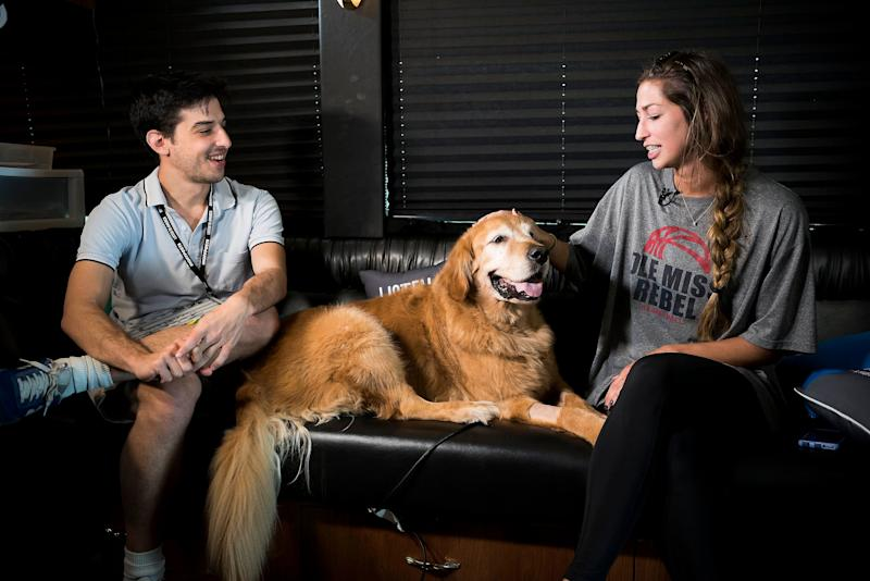 Sam Levine interviews Julia Tatumwhile her dog Bentley sits on the couch with them inside the HuffPost tour bus.