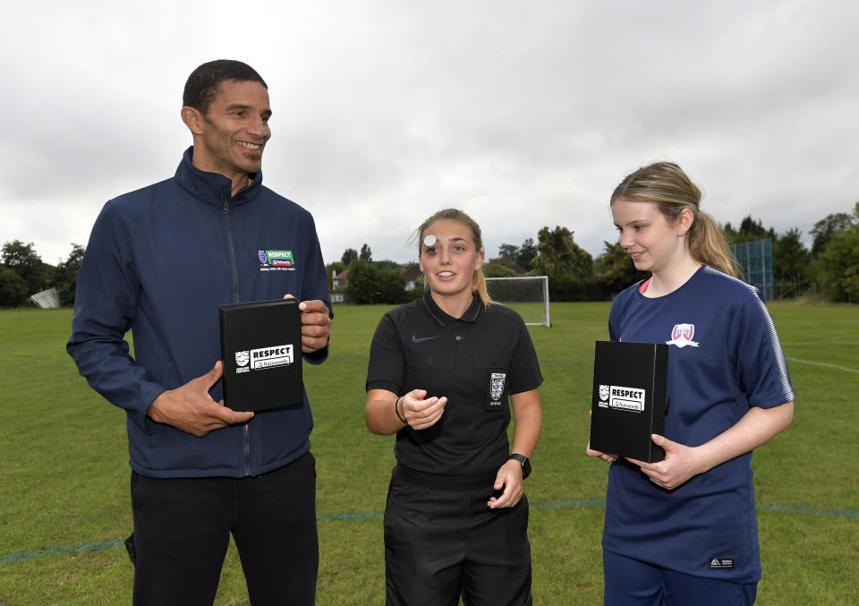 David James, referee Ella Broad and competition winner Chloe at the first Coin for Respect match
